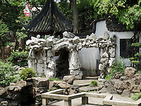 Yu Gardens, a peaceful place to escape the bustle of Shanghai.  Full of visitors, still very calming.  Details in the buildings, doors and stone sculptures.  Helps get your Ying and Yang in balance.