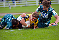 Aidan Morgan is tackled during the 2021 Bunnings Super Rugby Aotearoa Under-20 rugby match between the Hurricanes and Highlanders at Owen Delaney Park in Taupo, New Zealand on Tuesday, 14 April 2021. Photo: Dave Lintott / lintottphoto.co.nz