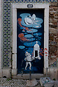 Street art depicting an octopus in a boat, a frog, jellyfish and a turret of the Fortaleza de Santiago, Sesimbra, Portugal.