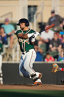 Justin Twine (1) of the Greensboro Grasshoppers follows through on his swing against the Kannapolis Intimidators at CMC-Northeast Stadium on August 1, 2015 in Kannapolis, North Carolina.  The Intimidators defeated the Grasshoppers 7-4.  (Brian Westerholt/Four Seam Images)