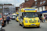 BNPS.co.uk (01202) 558833<br /> Pic: Zachary Culpin/BNPS<br /> <br /> Pictured: The convoy of ice-cream vans make their way through the town centre as people line the streets to pay their respects<br /> <br /> A much-loved ice cream seller was given a fitting send off by colleagues who followed his funeral cortege in a convoy of 10 ice cream vans. <br /> <br /> John Lennie spent over 40 years selling ice creams from his trusty van in his local community.<br /> <br /> So dedicated was he to his job that he was still doing his rounds just two days before he died at the age of 79.<br /> <br /> His daughter, Jemma Lennie, led the procession in her father's old colourful truck at his funeral in Wimborne, Dorset.