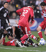 DC United  forward Luciano Emilio (11) being tackled by Chicago Fire defender Wilman Conde (22) and defender Dasan Robinson (32)l ,Chicago Fire tied DC United 1-1 at  RFK Stadium, Saturday March 28, 2009.