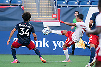 FOXBOROUGH, MA - JUNE 26: Michael Maldonado #15 of North Texas SC kicks a high ball downfield during a game between North Texas SC and New England Revolution II at Gillette Stadium on June 26, 2021 in Foxborough, Massachusetts.