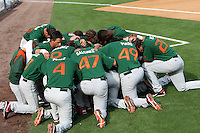 """Miami Hurricanes team prayer during a game vs. the University of South Florida Bulls in the """"Florida Four"""" at George M. Steinbrenner Field in Tampa, Florida;  March 1, 2011.  USF defeated Miami 4-2.  Photo By Mike Janes/Four Seam Images"""