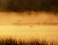 Fly fisherman on Davis Lake with fog. Oregon