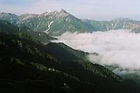 Mount Yari -- a slender pinacle of a peak in Japan's Hida Range -- rising above morning clouds.