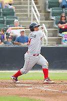 Willians Astudillo (11) of the Lakewood BlueClaws follows through on his swing against the Kannapolis Intimidators at CMC-NorthEast Stadium on July 20, 2014 in Kannapolis, North Carolina.  The Intimidators defeated the BlueClaws 7-6. (Brian Westerholt/Four Seam Images)