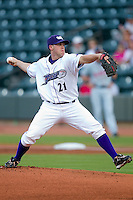 Starting pitcher Dylan Axelrod #21 of the Winston-Salem Dash delivers a pitch to the plate during Game Two of the Southern Division Play-offs against the Kinston Indians at  BB&T Ballpark September 9, 2010, in Winston-Salem, North Carolina.  Axelrod allowed three hits and zero runs over 6+ innings as the Dash defeated the Indians 2-0 to take a 2-0 lead in the series.  Photo by Brian Westerholt / Four Seam Images