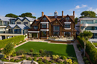 BNPS.co.uk (01202) 558833. <br /> Pic: TailorMade/BNPS<br /> <br /> Pictured: Harbour Gate has stunning views of Poole Harbour. <br /> <br /> A multi-millionaire is hoping to have a shot at selling his luxury mansion - by throwing a hi-tech golf simulator into the deal.<br />  <br /> Golf-loving Barry Bester put the waterfront property on Sandbanks, Dorset, on the market for £11m last year.<br />  <br /> He is now offering his £40,000 state-of-the-art simulator he has had built on the grounds with the sale.