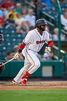 Rochester Red Wings first baseman Kennys Vargas (30) follows through on a swing during a game against the Lehigh Valley IronPigs on June 30, 2018 at Frontier Field in Rochester, New York.  Lehigh Valley defeated Rochester 6-2.  (Mike Janes/Four Seam Images)