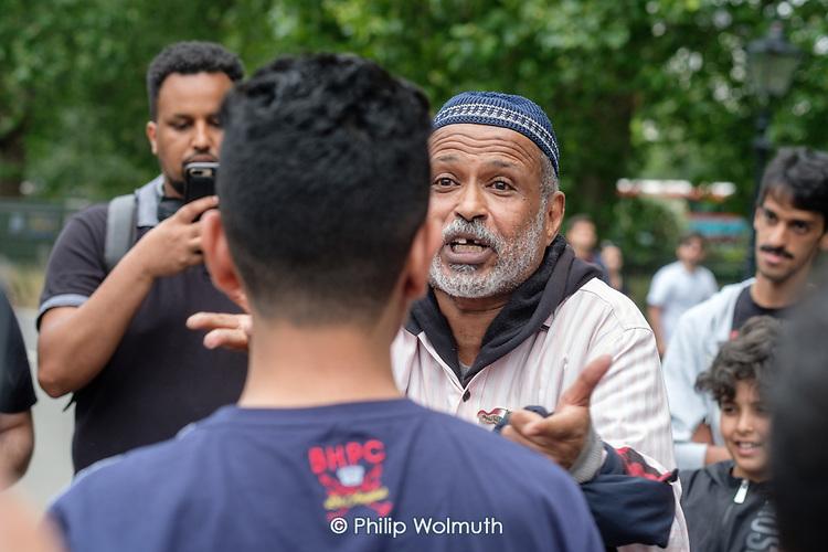 Debaters arguing in Arabic, Speakers' Corner, Hyde Park, London.
