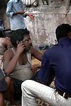 An Indian labour using a mobile phone on a road of  Kolkata, West Bengal,  India  7/18/2007.  Arindam Mukherjee/Landov