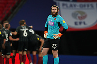 Goalkeeper Jonathan Maxted of Exeter City looks dejected as Northanpton celebrate scoring their fourth goal of the game during the Sky Bet League 2 PLAY-OFF Final match between Exeter City and Northampton Town at Wembley Stadium, London, England on 29 June 2020. Photo by Andy Rowland.