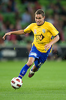 MELBOURNE, AUSTRALIA - OCTOBER 23: James Brown of Gold Coast controls the ball during the A-League match between the Melbourne Heart and Gold Coast United at AAMI Park on October 23, 2010 in Melbourne, Australia. (Photo by Sydney Low / Asterisk Images)