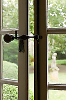 Traditional 18th century windows are held by a simple metal handle