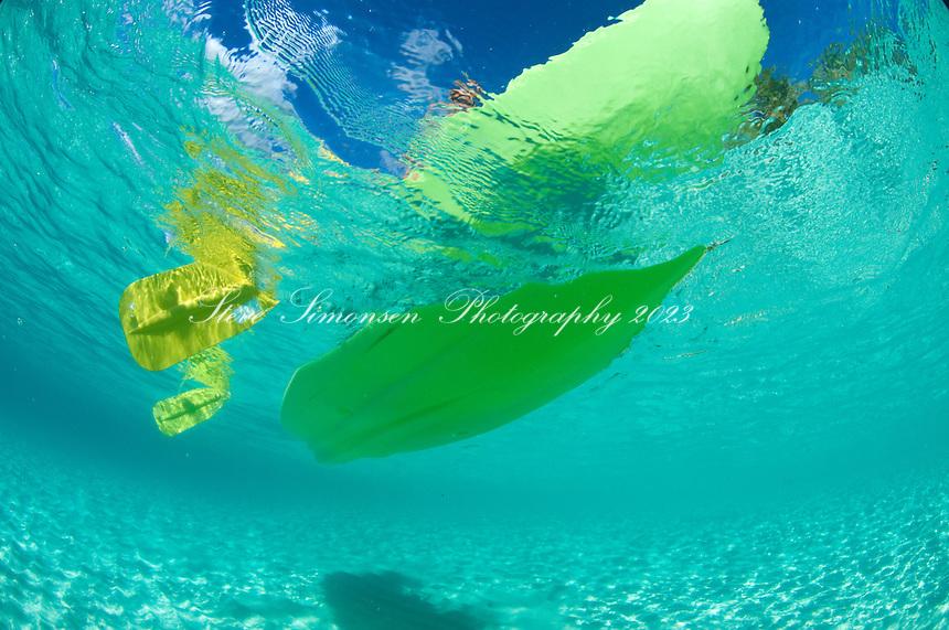 Looking up through clear water at <br /> kayakers at Honeymoon Beach<br /> Virgin Islands National Park<br /> St. John, U.S. Virgin Islands