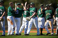 Dartmouth Big Green first baseman Michael Ketchmark (27) and third baseman Justin Fowler (25) high five teammates Ben Socher (26), Hayden Rappoport (20), Steffen Torgersen (29), and Michael Calamari (3) after a game against the Eastern Michigan Eagles on February 25, 2017 at North Charlotte Regional Park in Port Charlotte, Florida.  Dartmouth defeated Eastern Michigan 8-4.  (Mike Janes/Four Seam Images)