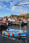 Great Britain, England, North Yorkshire, Whitby: View over fishing harbour to Saint Mary`s Church