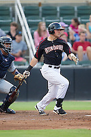 Trey Michalczewski (27) of the Kannapolis Intimidators follows through on his swing against the Charleston RiverDogs at CMC-NorthEast Stadium on June 27, 2014 in Kannapolis, North Carolina.  The Intimidators defeated the RiverDogs 6-5.  (Brian Westerholt/Four Seam Images)