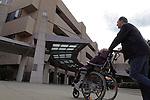 William Massart walks his daughter Sandra Massart, 10,  into Duke University Hospital in Durham, NC, USA, on Tuesday, Feb. 14, 2012.  Sandra Massart is being treated for MLD, a degenerative condition.  Photo by Ted Richardson