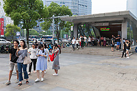 Suzhou, Jiangsu, China. Young Chinese in Casual Clothes Exiting from an Underground Metro Station.
