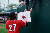New Hampshire Fisher Cats third baseman Vladimir Guerrero Jr. (27) signs autographs for fans before the first game of a doubleheader against the Harrisburg Senators on May 13, 2018 at FNB Field in Harrisburg, Pennsylvania.  New Hampshire defeated Harrisburg 6-1.  (Mike Janes/Four Seam Images)