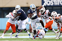 CHAPEL HILL, NC - OCTOBER 10: Javonte Williams #25 of North Carolina is tripped up by Chamarri Conner #22 of Virginia Tech during a game between Virginia Tech and North Carolina at Kenan Memorial Stadium on October 10, 2020 in Chapel Hill, North Carolina.