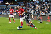 SAINT PAUL, MN - MAY 15: Hassani Dotson #31 of Minnesota United FC and Tanner Tessmann #15 of FC Dallas battle for the ball during a game between FC Dallas and Minnesota United FC at Allianz Field on May 15, 2021 in Saint Paul, Minnesota.
