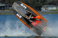 Frame 6: Bruce Hansen (44-W) blows over in a turn then turns upright after landing.....Stock  Outboard Winter Nationals, Ocoee, Florida, USA.13/14 March, 2010 © F.Peirce Williams 2010