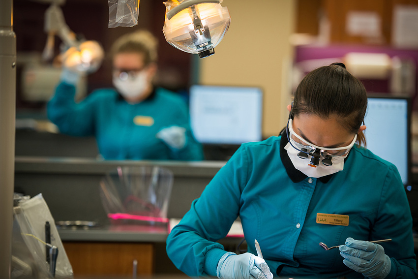 Dental Hygiene student Tiffany Wang works on a patient in the Dental Programs Clinic in UAA's Allied Health Sciences Building.