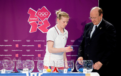 30 MAY 2012 - LONDON, GBR - Great Britain women's captain Lynn McCafferty (left), watched by IHF First Vice President Miguel Roca,  draws the balls for the men's group stage during the London 2012 Olympic Games Handball Draw at the National Sports Centre in Crystal Palace, Great Britain (PHOTO (C) 2012 NIGEL FARROW)