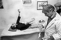 A father watches his son scream in agony as a doctor cleans his burn wounds in a hospital in the Afghan capital Kabul on January 13, 1989. The boy was injured when he picked up an unexploded magnesium flare, used by airplanes as countermeasures to heat-seeking missiles.