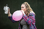 © Joel Goodman - 07973 332324 . 11/06/2016 . Manchester , UK . Reveller breathing from a balloon at the Parklife music festival at Heaton Park in Manchester . Photo credit : Joel Goodman