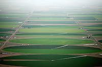 San Luis Valley with light drizzle, circle fields near Center, Colorado. July 2014. 86067