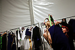 A model gets dressed before the Davidelfin show during the last day of the Mercedes-Benz Spring 2011 Fashion Week at the Lincoln Center on Thursday, September 16, 2010.