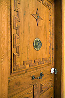 An original carved door set off with contemporary iron hardware in Can Bonastre, a five star hotel