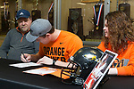 December 23, 2017- Tuscola, IL- Tuscola's Hunter Woodard during his signing ceremony to play football at Oklahoma State as his parents Bob and Jennifer look on. [Photo: Douglas Cottle]