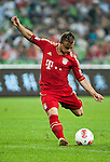 GUANGZHOU, GUANGDONG - JULY 26:  Xherdan Shaqiri of Bayern Munich in action during a friendly match against VfL Wolfsburg as part of the Audi Football Summit 2012 on July 26, 2012 at the Guangdong Olympic Sports Center in Guangzhou, China. Photo by Victor Fraile / The Power of Sport Images