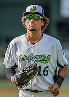 31 July 2016: Vermont Lake Monsters outfielder Luis Barrera returns to the dugout between innings of a game against the Connecticut Tigers at Centennial Field in Burlington, Vermont. The Lake Monsters edged out the Tigers 4-3 in NY Penn League action.  Mandatory Credit: Ed Wolfstein Photo *** RAW (NEF) Image File Available ***