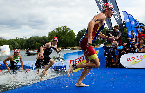 25 JUL 2010 - LONDON, GBR - Jose Miguel Perez prepares himself to re enter the water after completing the first swim lap at the mens race of the London round of the ITU World Championship Series triathlon (PHOTO (C) NIGEL FARROW)