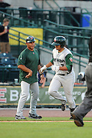 Fort Wayne TinCaps second baseman Diego Goris (7) congratulated by manager Jose Valentin after hitting a home run during a game against the Great Lakes Loons on August 19, 2013 at Dow Diamond in Midland, Michigan.  Great Lakes defeated Fort Wayne 12-5.  (Mike Janes/Four Seam Images)
