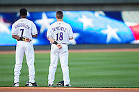 Tim Anderson (7) and Joey DeMichele (18) of the Winston-Salem Dash during the National Anthem prior to the Carolina League game against the Wilmington Blue Rocks at BB&T Ballpark on April 5, 2014 in Winston-Salem, North Carolina.  The Dash defeated the Blue Rocks 3-2.  (Brian Westerholt/Four Seam Images)