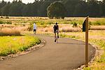 A man biking on a path at Graham Oaks.