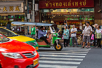 Bangkok, Thailand.  Pedestrians waiting at Crosswalk, Yaowarat Road, Chinatown.