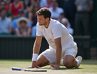 England, London, 28.06.2014. Tennis, Wimbledon, AELTC, Men's semifinal between Novak Djokovic  (SRB) and Grigor Dimitrov (BUL), Pictured: Grigor Dimitrov is on his knees<br /> Photo: Tennisimages/Henk Koster