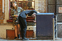 Pictured: A man throws up in Wind Street, Swansea. Monday 31 December 2018 and Tuesday 01 January 2019<br /> Re: New Year revellers in Wind Street, Swansea, Wales, UK