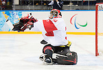 Sochi, RUSSIA - Mar 11 2014 -  Corbin Watson makes  a save as Canada takes on Czech Republic in Sledge Hockey at the 2014 Paralympic Winter Games in Sochi, Russia.  (Photo: Matthew Murnaghan/Canadian Paralympic Committee)