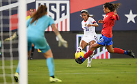 JACKSONVILLE, FL - NOVEMBER 10: Margaret Purce #30 of the USA crosses a ball past Stephannie Blanco #15 of Costa Rica during a game between Costa Rica and USWNT at TIAA Bank Field on November 10, 2019 in Jacksonville, Florida.