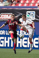 D.C. United's Bryan Namoff and the MetroStars' John Wolyniec battle for a ball during first half action between DC United and the NY/NJ MetroStars at the MetroStars home opener at Giant's Stadium, East Rutherford, NJ, on April 17, 2004.