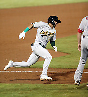 Luis Barrera of the Mesa Solar Sox hits an inside-the-park home run in the 9th inning of the opening night Arizona Fall League game against the Scottsdale Scorpions at Scottsdale Stadium on October 9, 2018 in Scottsdale, Arizona(Bill Mitchell)
